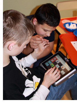 Boys using AAC Device